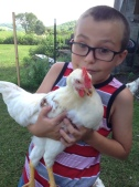 A boy and his chick.