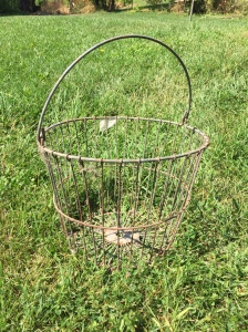My parents found it on the farm back in 1977, when they bought the farm.  It was left by the previous owner.  Mom used it for eggs, gathering vegetables, and it even served as an Easter basket for me, one year.